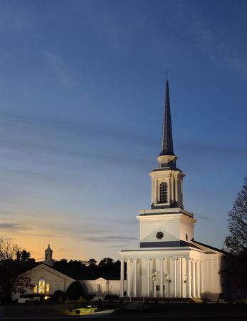 Steeple of a southern Baptist Church in rural surroundings. Stock Photo - 8407212