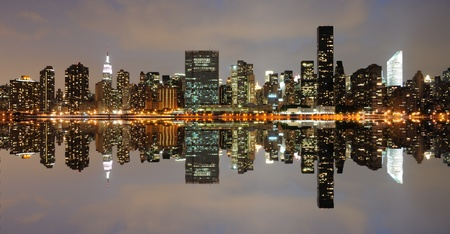 The Lower Manhattan Skyline with serious reflections in New York City. Stock Photo - 8407220