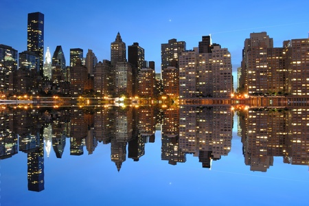 The Lower Manhattan Skyline with serious reflections in New York City. Stock Photo - 8407224