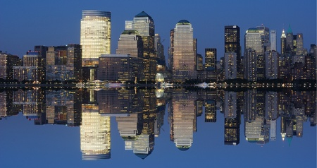 The Lower Manhattan Skyline with serious reflections in New York City. Stock Photo - 8407234