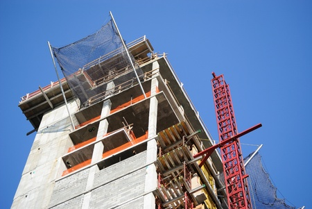 A building under construction with safety netting.