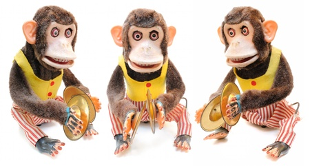 monkey with cymbals isolated on white