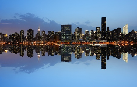 The Lower Manhattan Skyline with serious reflections in New York City. Stock Photo - 8407218
