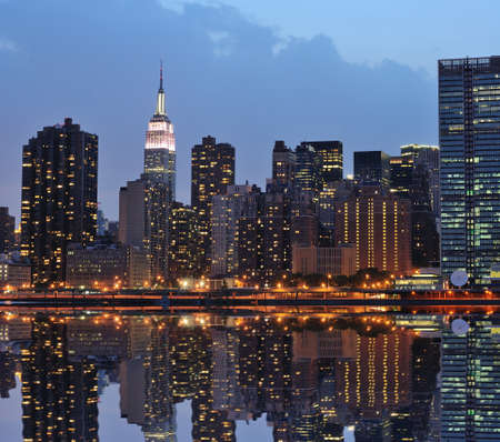 The Lower Manhattan Skyline with serious reflections in New York City. Stock Photo - 8407263