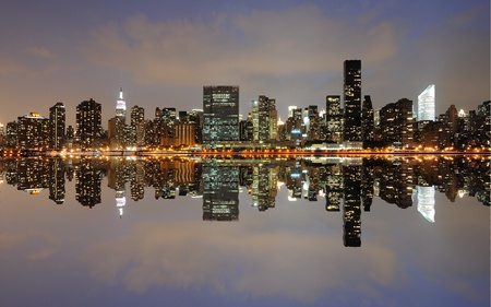 The Lower Manhattan Skyline with serious reflections in New York City. Stock Photo - 8407221