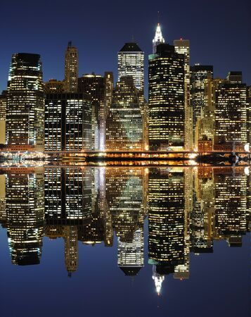 The Lower Manhattan Skyline with serious reflections in New York City. photo