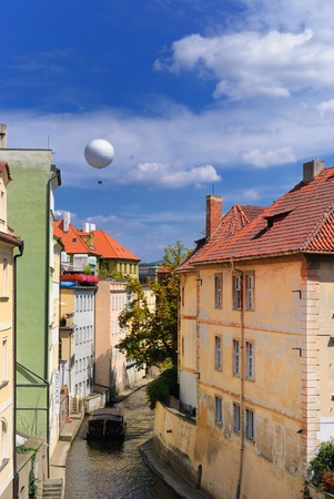 Hot air balloon over a the Chertovka River, a small tributary off the Vltava River, in Prague, Czech Republic. photo