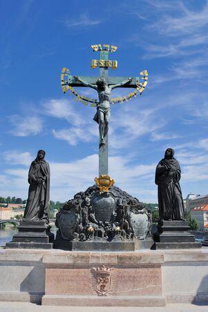 Crucfix and calvary on Charles Bridge in Prague, Czech Republic Stock Photo - 8552131