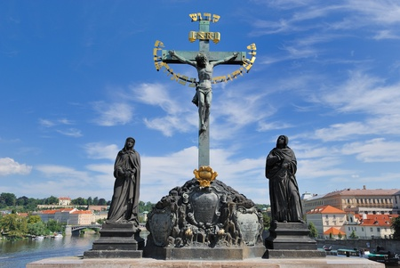 Crucfix and calvary on Charles Bridge in Prague, Czech Republic photo