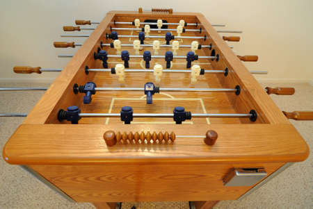 Foosball table in a carpeted room photo