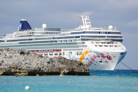 anchoring: Great Stirrup Cay, Bahamas, January 1, 2011: The luxury cruise liner Norwegian Pearl anchored off the coast of the Bahamas.