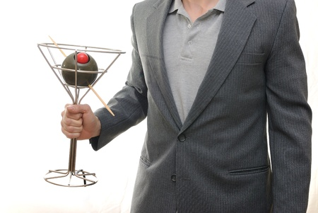 the novelty: A guy in a sports coat isolatd on white holding a large novelty Martini.