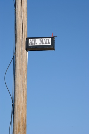 humorously: A mailbox humorously placed high on a telephone pole.