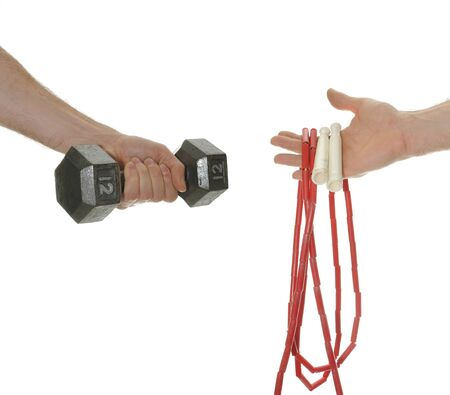 cardiovascular exercising: Hands holding weights and jump rope for weight lifting and cardio.