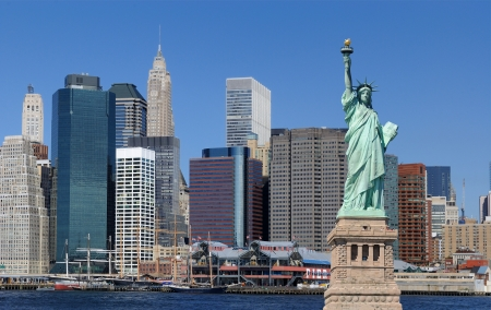 famous statues: The landmark Statue of Liberty against the impressive New York City skyline.