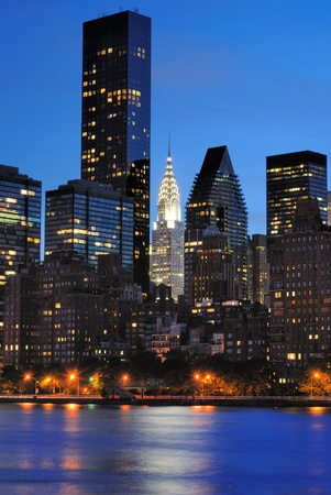 Vertical view of the New York City skyline at midtown Manhattan from across the East River. photo