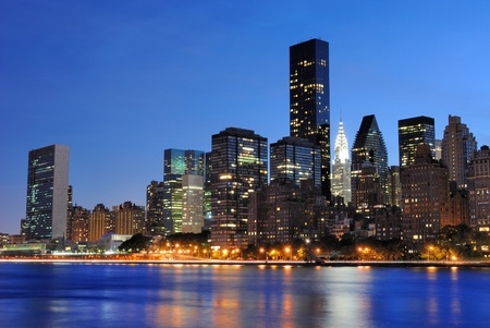 lighting: Vertical view of the New York City skyline at midtown Manhattan from across the East River.