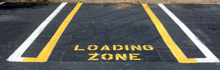 Parking spot designated for loading and unloading only. Stock Photo - 8871456
