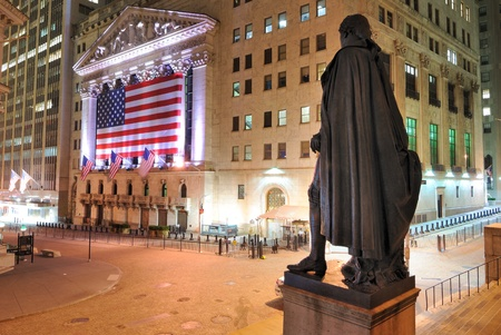 stock exchange: NEW YORK CITY - MAY 26: Behind the George Washington Statue looking towards the New York Stock Exchange on Wall Street May 26, 2010 in New York, NY.