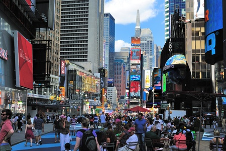 square: NEW YORK CITY - JUNE 26: Crowds in TImes Square July 26, 2010 in New York, NY.