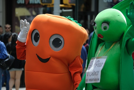 NEW YORK CITY - MAY 16: Participants in the Vegetarian Pride Parade wear costumes in support of their meatless diets May 16, 2010 in New york, NY. Stock Photo - 8796935