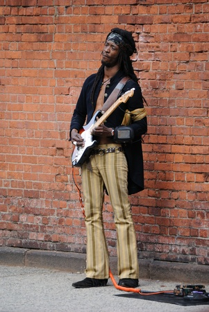 NEW YORK CITY - MAY 22: A busker performs Jimi Hendrix songs and dresses as Hendrix in the West Village May 22, 2010 in New York, NY.