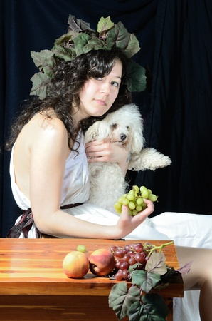 A female version of Bacchus, the roman god of the grape harvest. photo