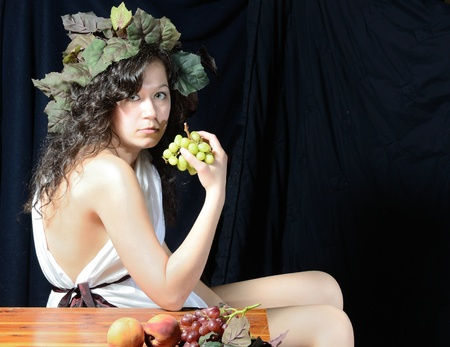 toga: A female version of Bacchus, the roman god of the grape harvest.