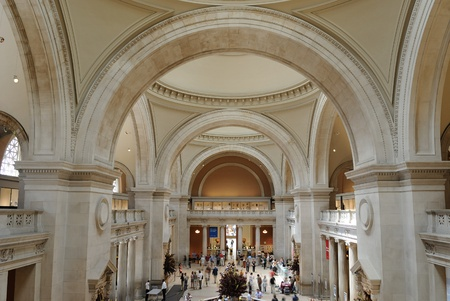 famous places: Tourists mill about in the Metropolitan Museum of Arts Great Hall in New York City. May 26, 2010.