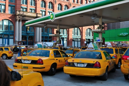 New York City - April 8, 2010: Taxis line up for gas at a BP in New York City. Stock Photo - 9020217