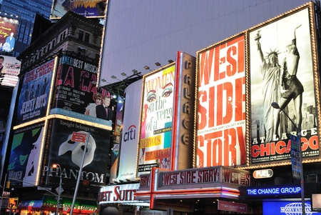 Theater and production advertisements in Times Square New York City at dawn. Septembr 5, 2010.