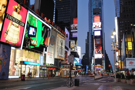 Storefronts and advertisements in Times Square New York City at dawn. Septembr 5, 2010. Stock Photo - 9020253