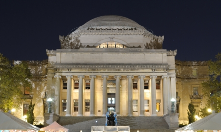 campus: The Library of Columbia Universary with crowds below for a festival in New York City.