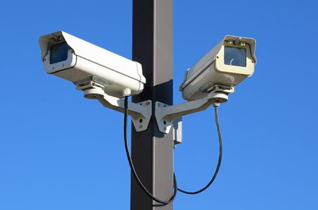 Dual security cameras on a pole Stock Photo - 9185517