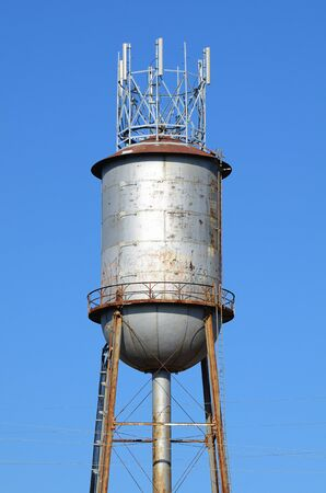 industrial water tower with antenna on top Stock Photo - 9185484
