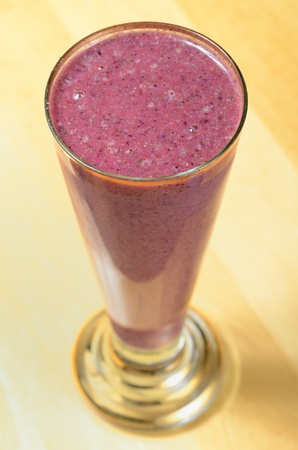 A smoothie in a glass on a table. photo