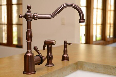 Faucet in a kitchen sink Stock Photo - 9185543