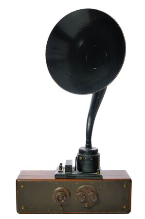 An antique radio with a speaker horn. Imagens