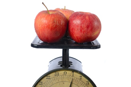 One pound of red apples on an old vintage scale. photo