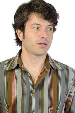 sideburns: Close up portrait of a young adult male in a casual button up shirt. Stock Photo