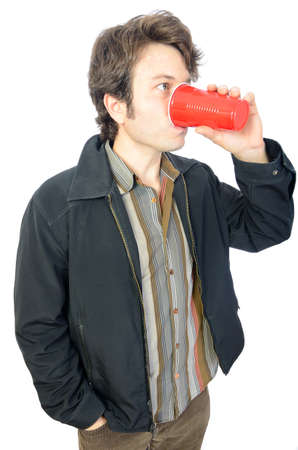 Man drinking from a red plastic cup. photo