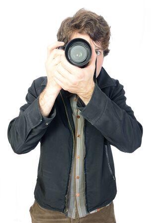 finer: Un chico centr�ndose manualmente una c�mara r�flex digital