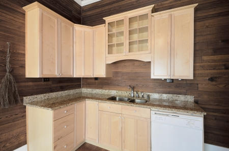 cabinets: Wood cabinets in a home kitchen