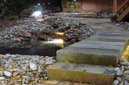 outdoor lighting: waterfall and rock stream