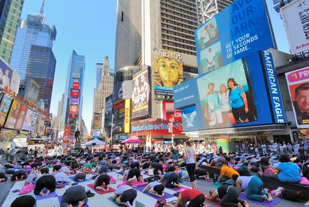 square: People participate in a yoga event in Times Square New York City. June 21, 2010. Editorial