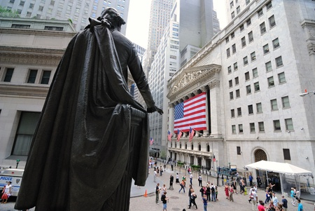 A view from Federal Hall and the Statue of George Washington looking towards the Stock Exchange on Wall Street  in New York City. June 4, 2010.