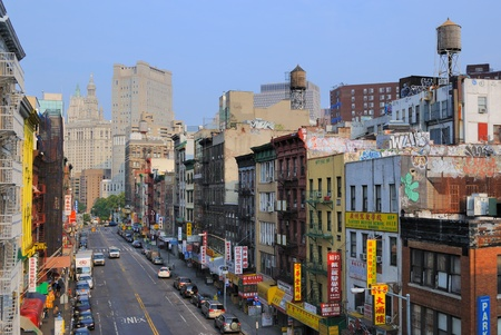 Shops and apartments down East Broadway in Chinatown, New York City. June 20, 2010. Stock Photo - 9475314