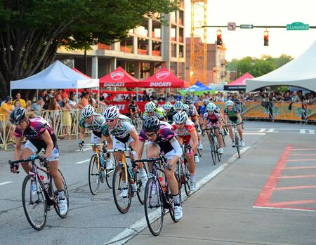 ATHENS, GEORGIA - April 30: Cyclists round a turn in Athens Twilight Criterium, the first nighttime race in the United States May 30, 2011 in Athens, GA, USA. Stock Photo - 9475283