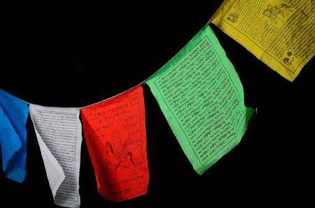 Tibetan prayer flags isolated on black. photo