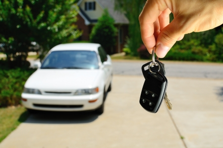 cars parking: Handing over the keys to a used car.